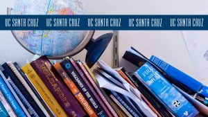 Photo of books and a globe with the blue logo stripe across the top
