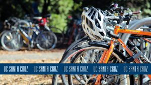 Photo of bicycles with blue logo stripe across the bottom